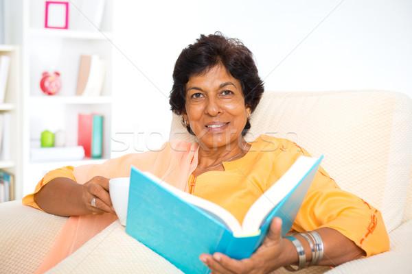 Mature Indian woman reading book Stock photo © szefei