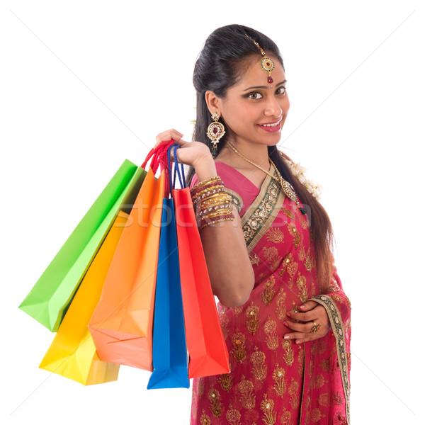 Happy Indian woman shopping Stock photo © szefei