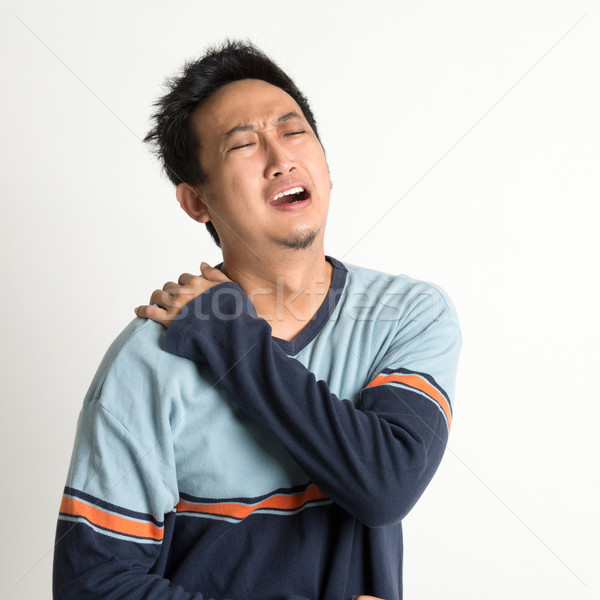 Shoulder pain Stock photo © szefei