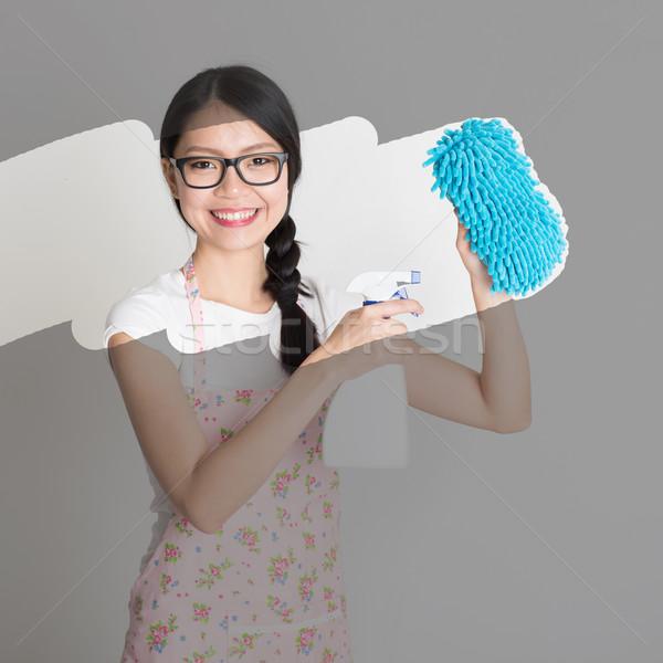 Asian woman doing house chores. Stock photo © szefei
