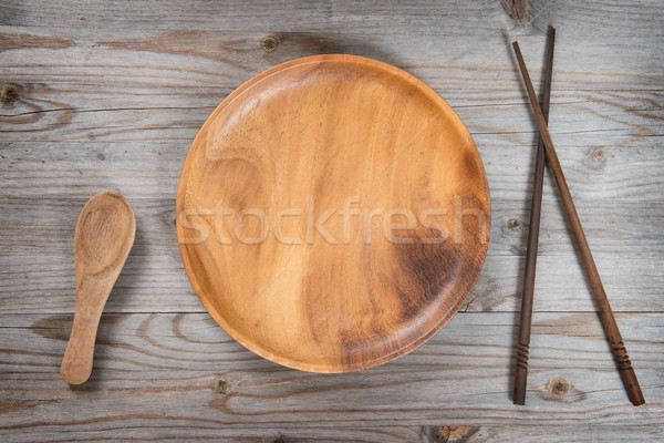 Empty plate, spoon and sushi chopsticks  Stock photo © szefei