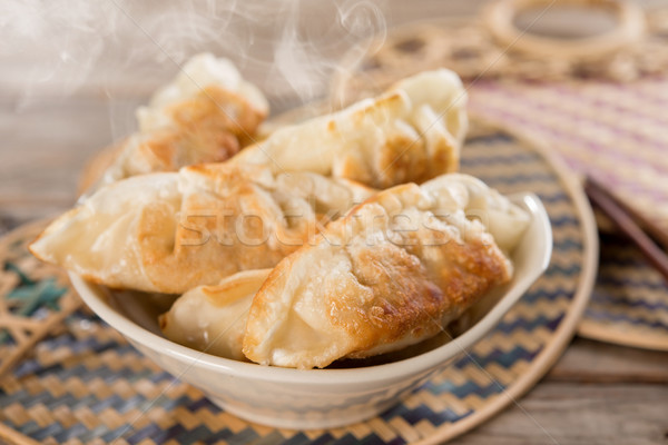 Famous Asian gourmet pan fried dumplings Stock photo © szefei