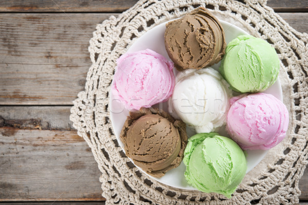Top view assorted ice cream on wood background. Stock photo © szefei
