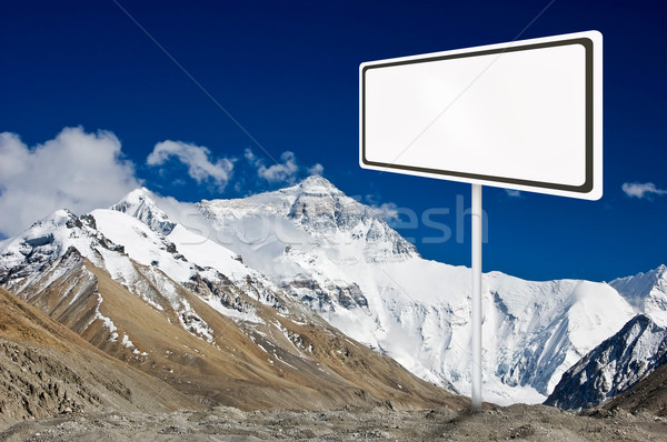 Blank billboard surround by mountain range. Stock photo © szefei