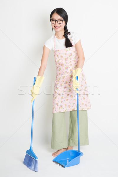 Sweeping floor  Stock photo © szefei