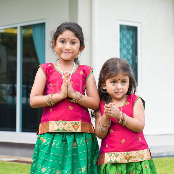 Cute Indian girls in sari greeting Stock photo © szefei