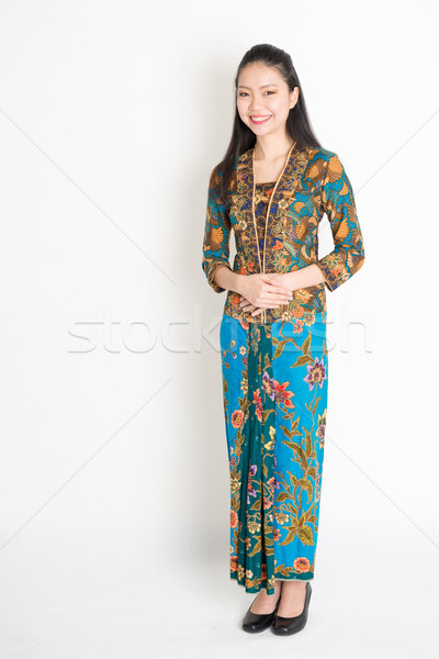 Southeast Asian woman in batik dress  Stock photo © szefei