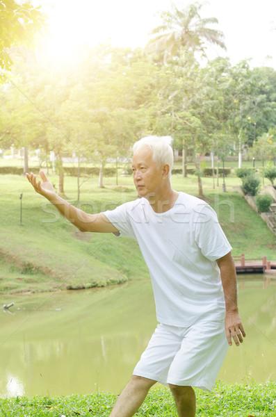 Senior man workout outdoor  Stock photo © szefei