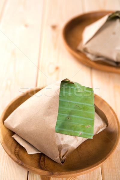 Nasi Lemak packed in banana leaf Stock photo © szefei