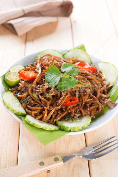 Asian spicy fried noodles Stock photo © szefei