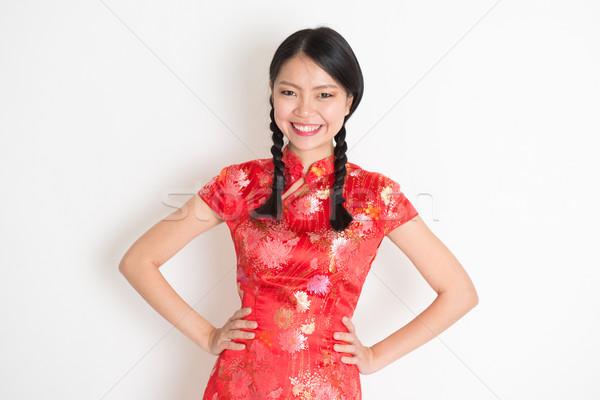 Asian chinese girl in qipao Stock photo © szefei