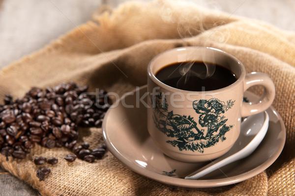 Traditional oriental Hainan coffee in vintage mug Stock photo © szefei
