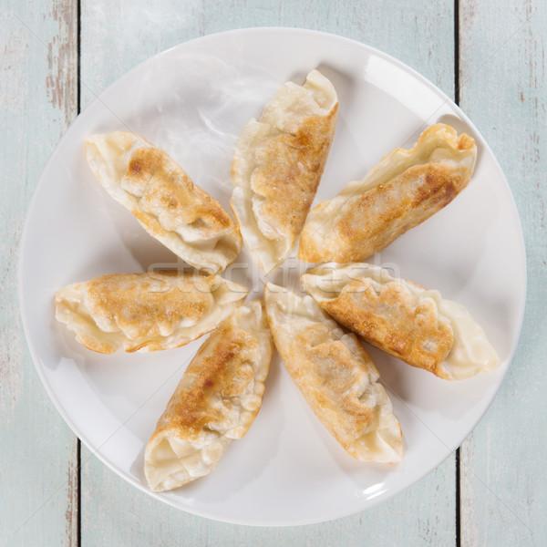 Top view Asian dish pan fried dumplings Stock photo © szefei