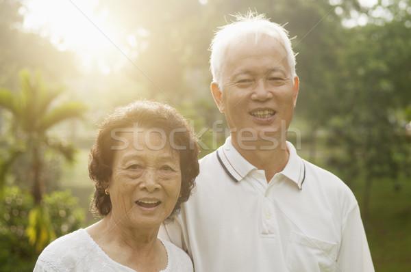 Asian seniors couple at nature park Stock photo © szefei