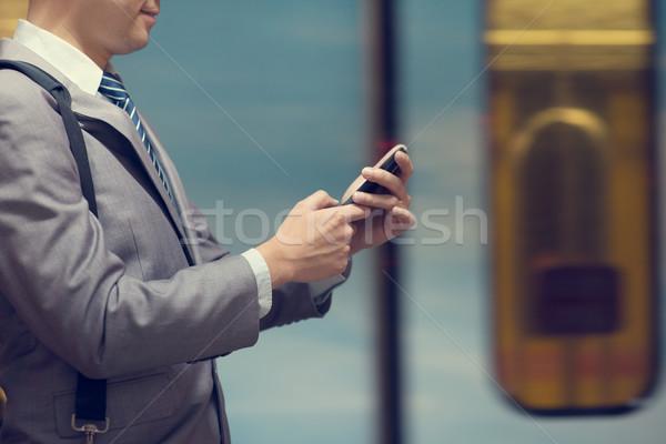 Stockfoto: Zakenman · treinstation · zakenlieden · hand · metro