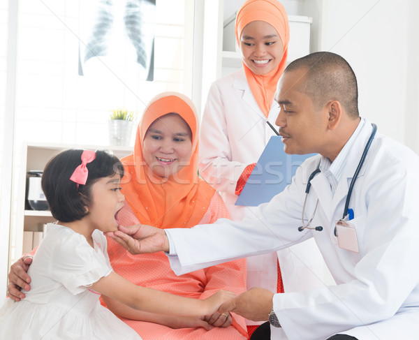 Southeast Asian medical doctor and patient Stock photo © szefei