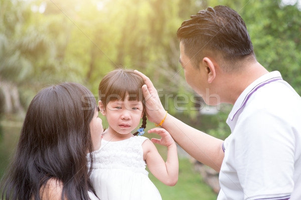 Parents comfort crying daughter Stock photo © szefei