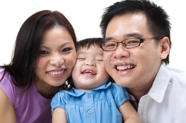 Família feliz feliz asiático família branco menina Foto stock © szefei