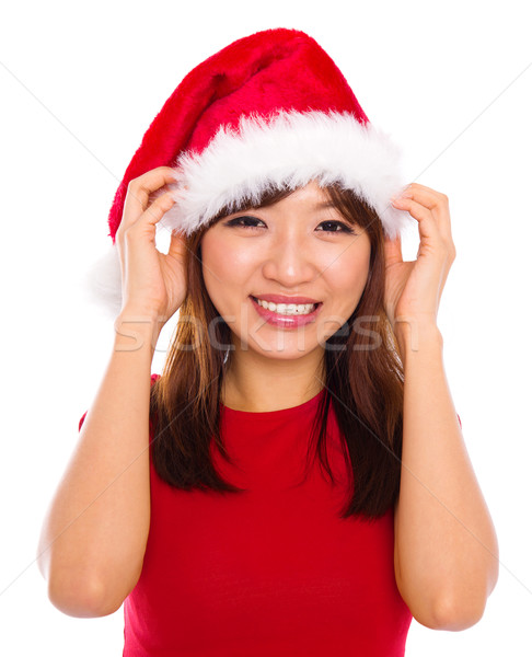 Asian woman in santa clause hat Stock photo © szefei