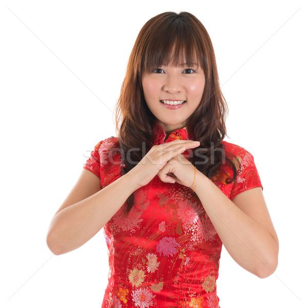 Chinese cheongsam girl greeting Stock photo © szefei