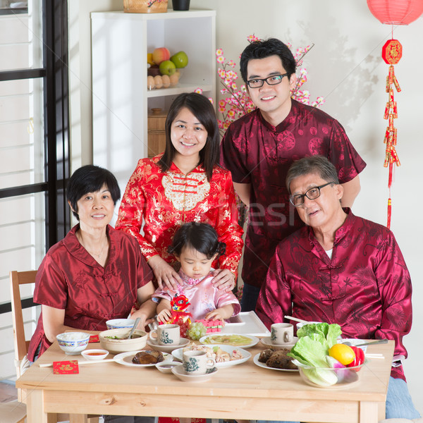 Chinese New Year reunion dinner group photo Stock photo © szefei