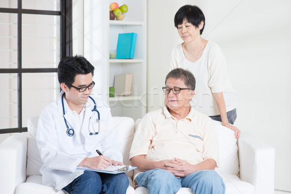 Doctor with old patient Stock photo © szefei