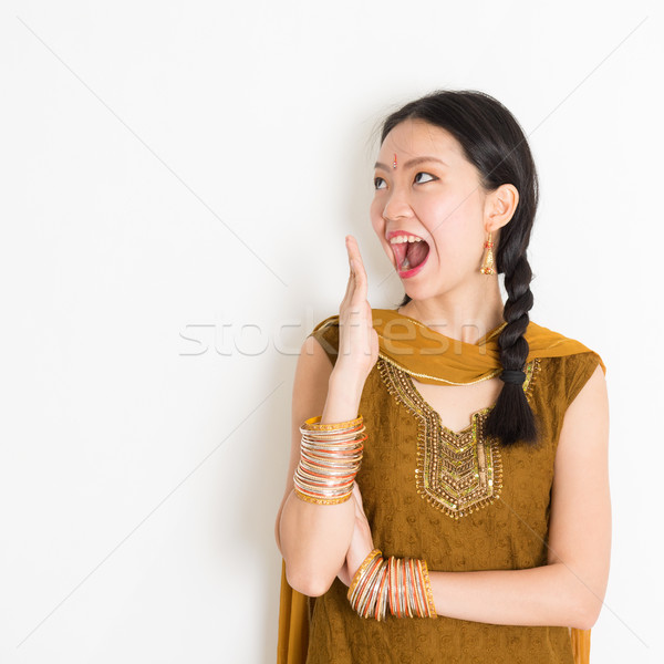 Stock photo: Mixed race Indian woman getting surprised