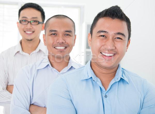 Sudeste asiático em pé escritório feliz Foto stock © szefei