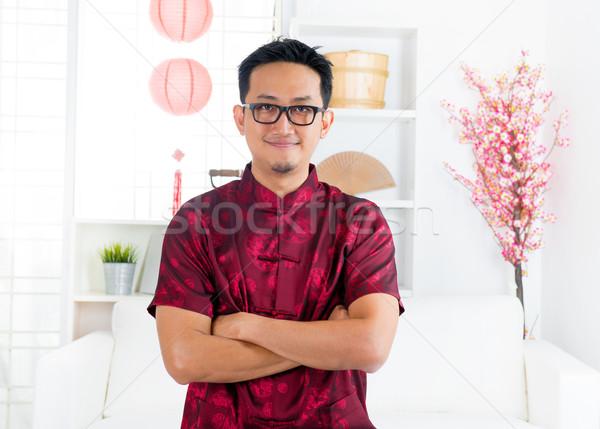 Chinese man standing indoors Stock photo © szefei