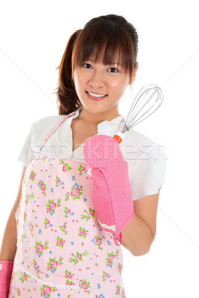 Asian girl holding egg beater  Stock photo © szefei