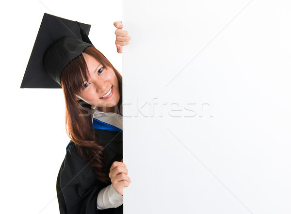 Graduate student hiding behind blank placard Stock photo © szefei
