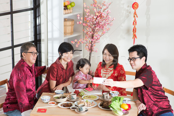 Selfie during Chinese New Year Reunion Dinner Stock photo © szefei