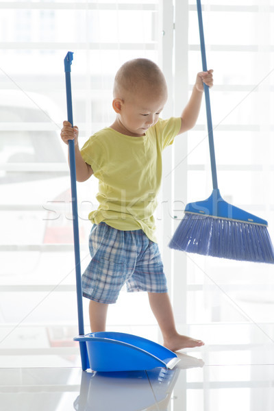 Toddler sweeping floor Stock photo © szefei