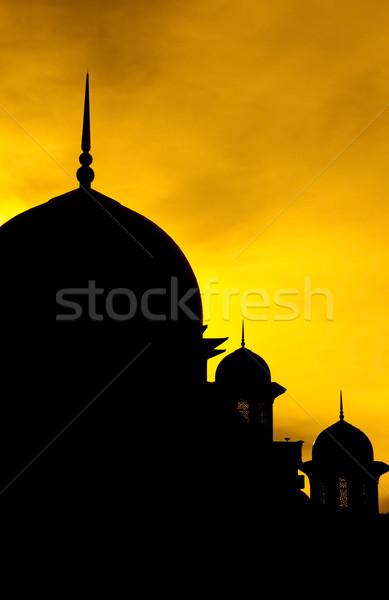 Silhueta mesquita pôr do sol fundo laranja nascer do sol Foto stock © szefei