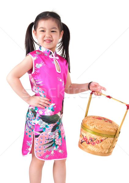 Oriental girl in chinese red cheongsam dress Stock photo © szefei