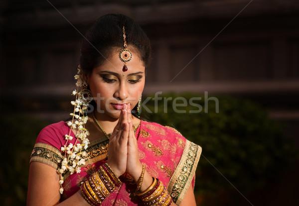 Young Indian girl praying Stock photo © szefei
