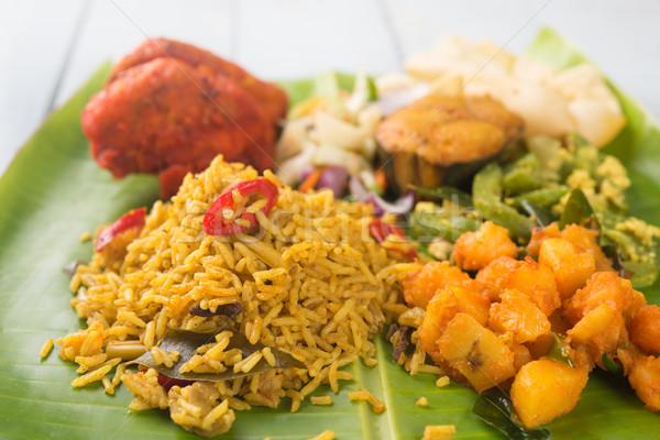 Indian biryani rice on banana leaf. Stock photo © szefei