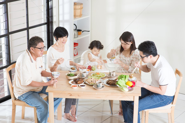 Asian Chinese family dinner Stock photo © szefei