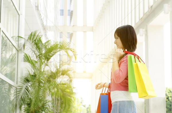 Asian woman holding shopping bags Stock photo © szefei