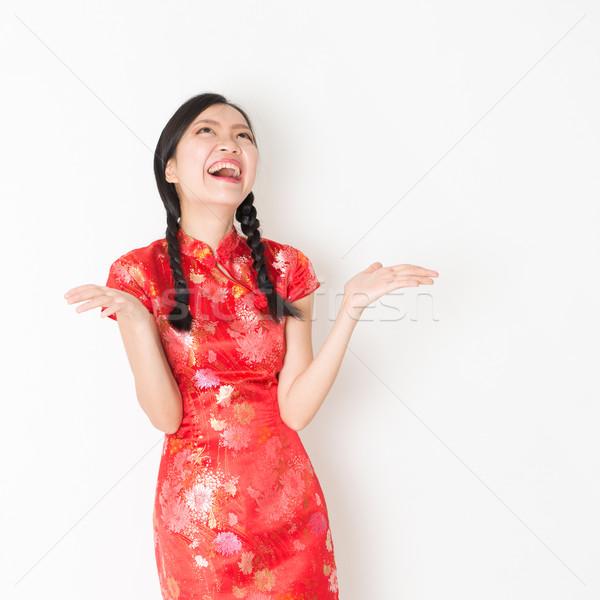 Surprised oriental girl in red qipao  Stock photo © szefei