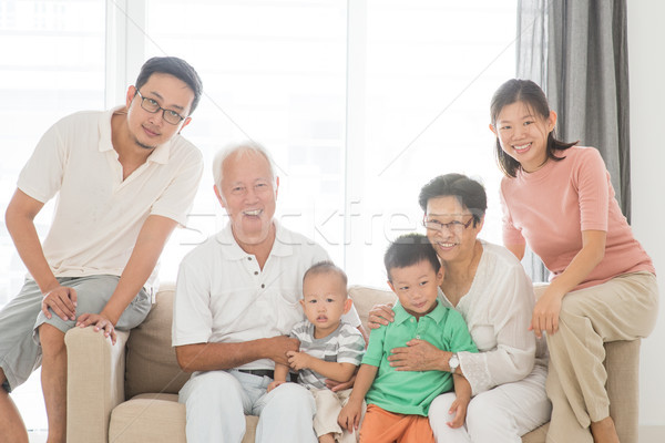 Happy multi generations family portrait Stock photo © szefei