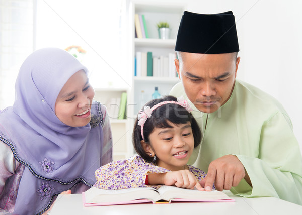 Malay Muslim parents teaching child Stock photo © szefei