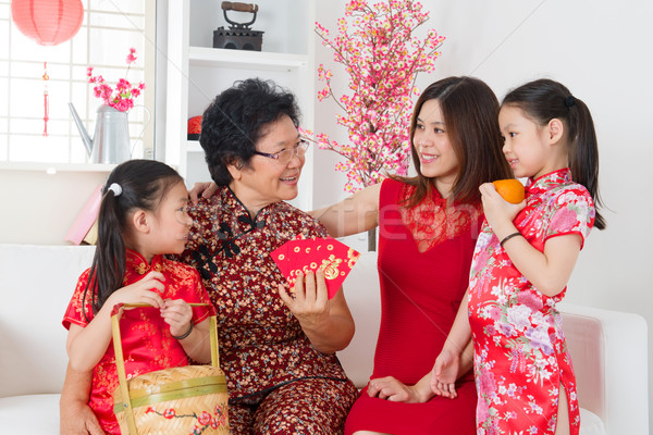 Asian family celebrate Chinese new year at home. Stock photo © szefei