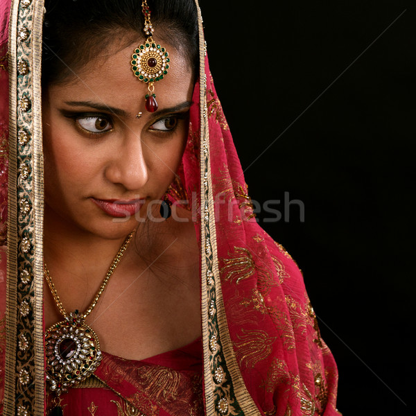 Indian girl looking at side space Stock photo © szefei