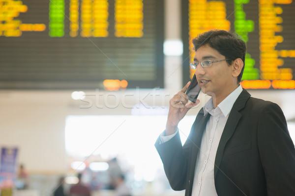 Indian Business man at airport Stock photo © szefei