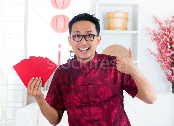 Thumb up Asian Chinese male Stock photo © szefei