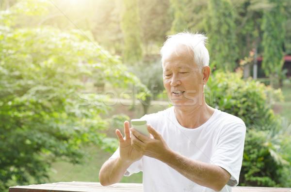 Asian old man on the phone  Stock photo © szefei