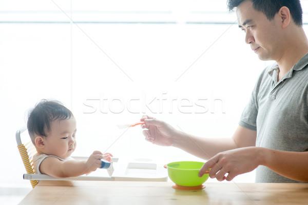 Baba bebek katı gıda mutlu Stok fotoğraf © szefei