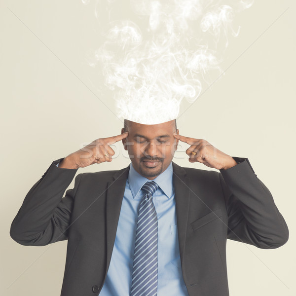 Stock photo: Indian businesspeople head burnout