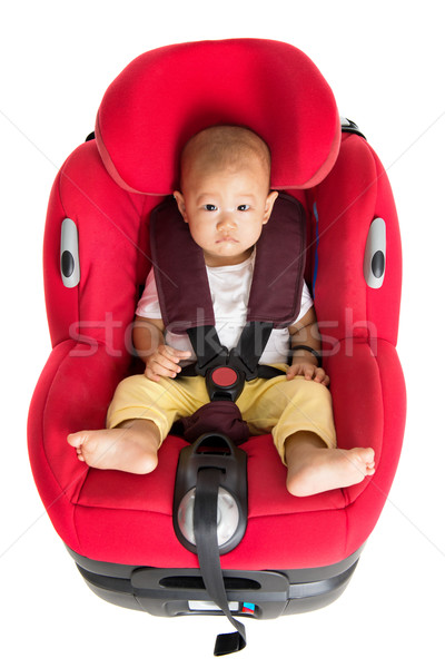 Baby boy sitting in car seat isolated Stock photo © szefei